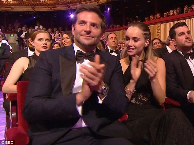Date night: Suki Waterhouse accompanied Hollywood heartthrob Bradley Cooper to the BAFTA Awards in London on Sunday night