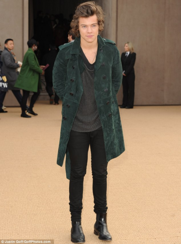Leading the way: Harry Styles looked dapper in a green suede coat as he attended the Burberry Prorsum fashion show at Kensington Gardens on Monday