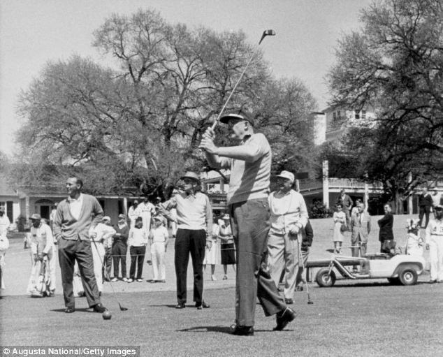 President Dwight D. Eisenhower tees off at Augusta as Arnold Palmer, then club chairman Clifford Roberts and an unknown player look on