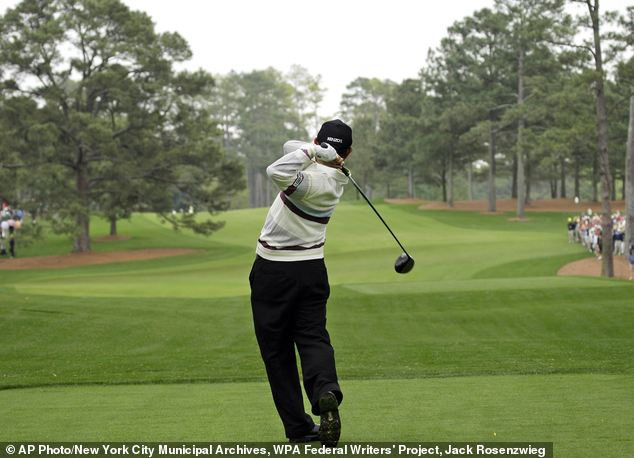 Toru Taniguchi of Japan tees off on the 17th hole of the Augusta National Golf Club, with the Eisenhower Tree at left, in 2008