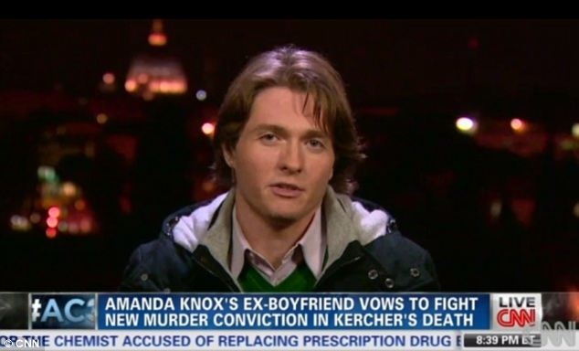 In the area: Raffaele Sollecito was in the Italian court for much of the appeals trial but was thought to be planning an escape from the country after he was reconvicted so authorities took away his passport