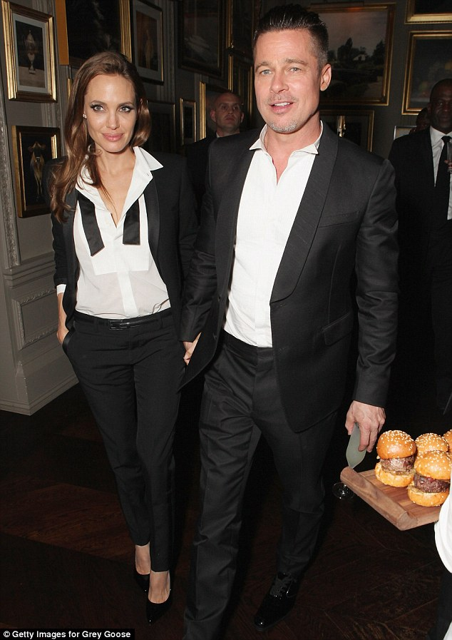 Matching: The duo sported nearly matching tuxedos