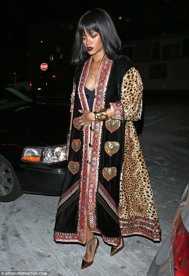 Wacky style: Rihanna wore a dramatic long coat to dine at Giorgio Baldi in Los Angeles on Sunday night