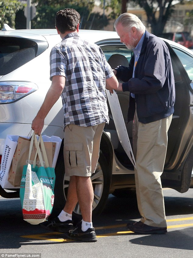 Meeting point: The actor was spotted in the car park of a local grocery store where he also picked up some food items