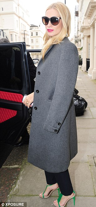 Spot the fashionista: Poppy Delevingne wore an eye-catching shirt for the occasion