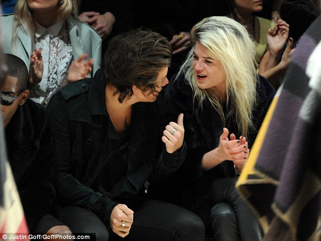 Catching up: Harry chatted to Alison Mosshart on the front row