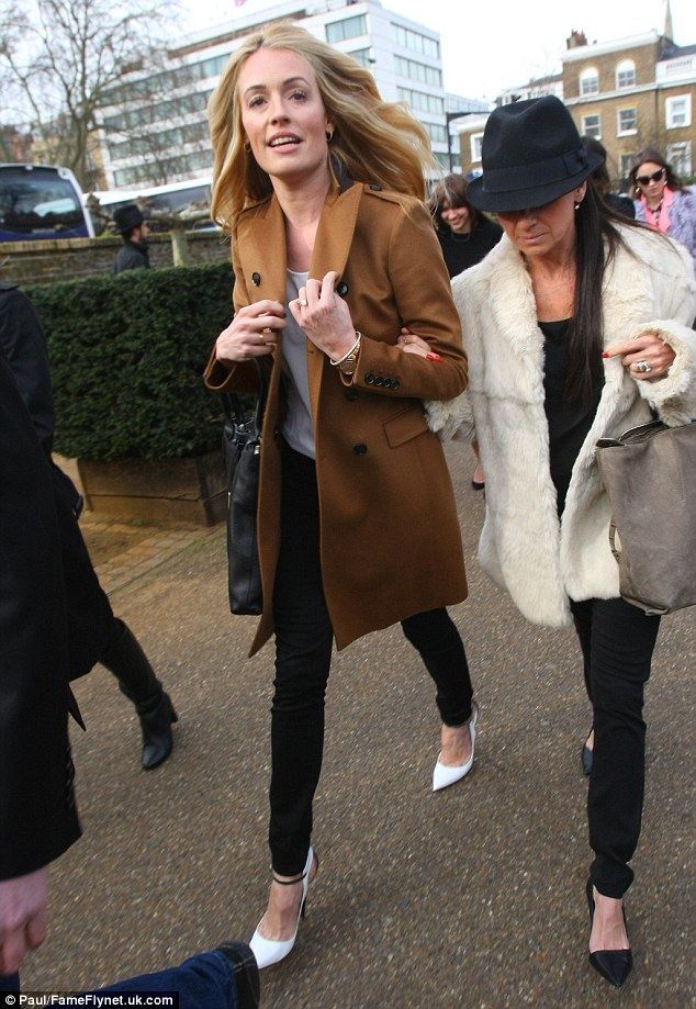 On the move: Cat flew in from New York to attend Fashion Week, and spend Valentine's Day with her husband Patrick Kielty