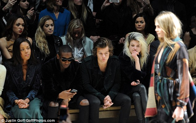 Taking it in: Naomie, Tinie, Harry and Alison Mosshart watch as Cara Delevingne walks the runaway