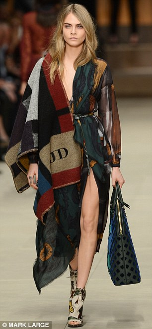 Leading the way: Cara Delevingne hits the runway for Burberry