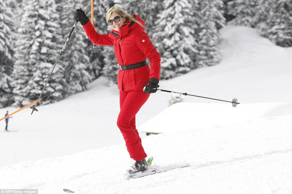 Queen Maxima waves at cameras as she makes her way down the slope. Days ago she was in Sochi supporting the Dutch skiing talent at the Winter Olympics