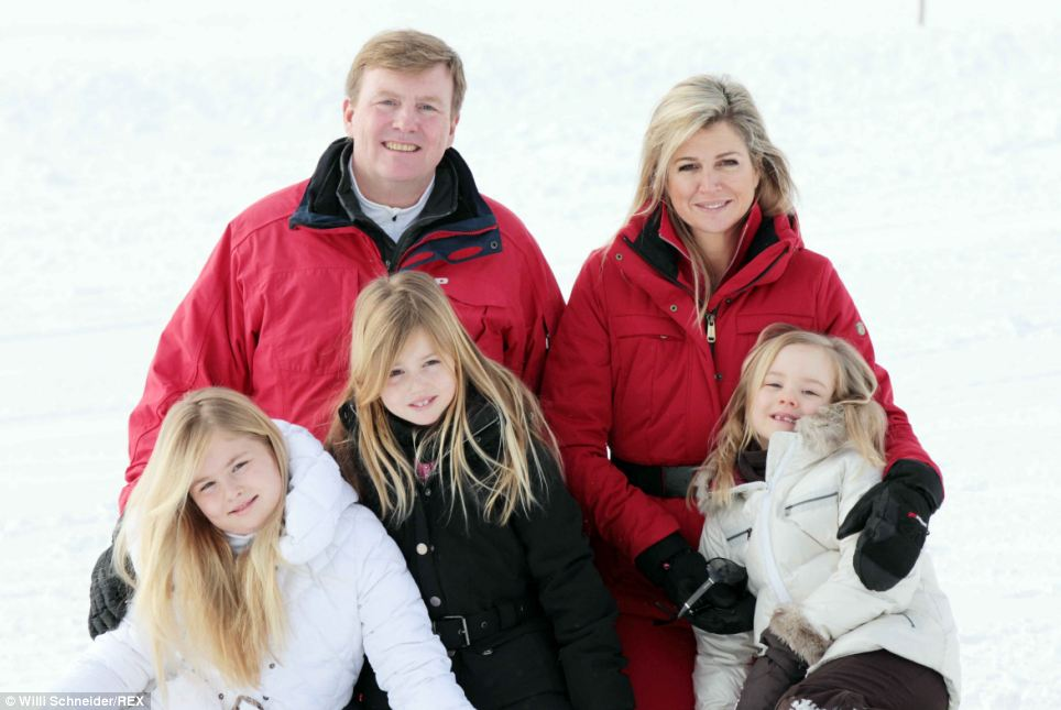 The little girls look adorable as they smile with their parents before taking to the slopes