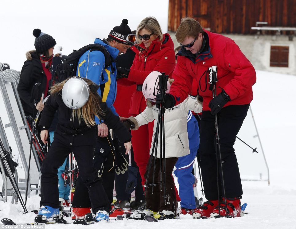 Helping hand: King Willem-Alexander shows his fatherly touch helping Ariane get her balance and holding her poles
