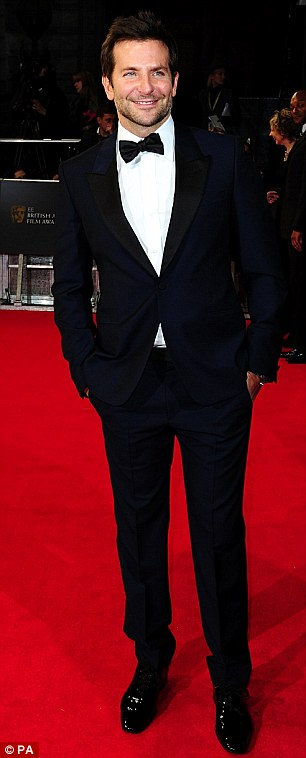 Going solo: Bradley posed alone on the red carpet as Suki arrived later