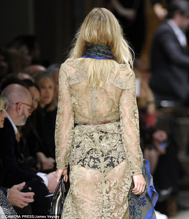 Peachy: Suki wore high-waisted and high-cut black pants under the lacy outfit but Bradley's mind seemed elsewhere