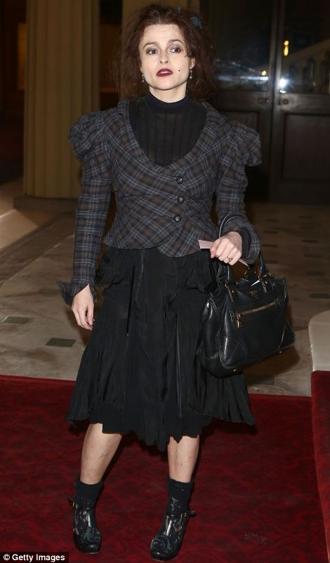 Helena Bonham Carter looked her typical quirky self in a black and dark brown ensemble, which she accessorised with a black handbag and dark red lipstick