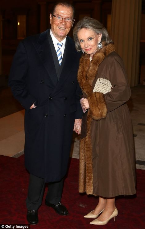 Sir Roger Moore and Kristina Tholstrup attend a Dramatic Arts Reception at Buckingham Palace