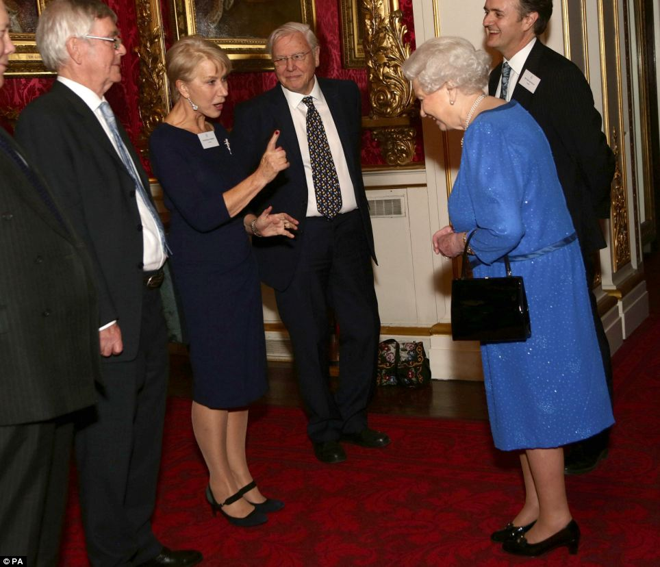Having words: Dame Helen Mirren (pictured with Sir David Attenborough, third left) appears to be having words with the Queen about the moment Prince William presented her with a BAFTA fellowship award. She can be seen wagging her finger at the head of state at a glittering reception at Buckingham Palace this evening