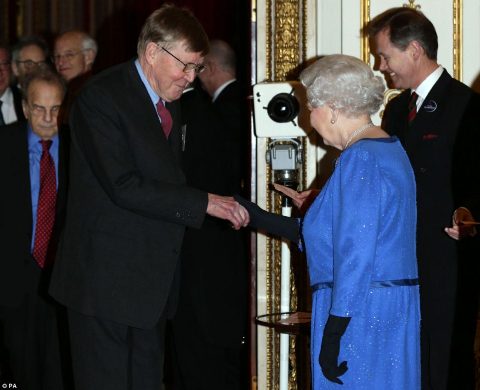 Pleased to meet you: Queen Elizabeth II meets playwright, actor and author Alan Bennett during the reception