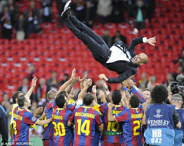 Flying high: Pep Guardiola is thrown aloft by his players following Barcelona's 2011Champions League win
