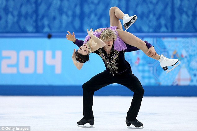 Flawless: White and Davis perform a lift at the Iceberg Skating Palace in Sochi