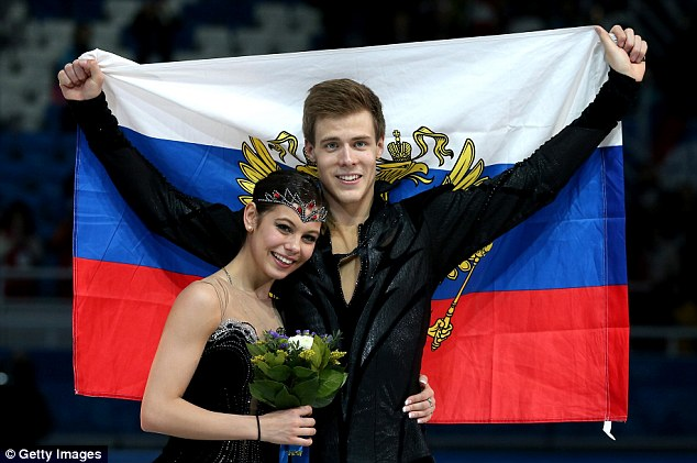 Big future: Bronze medallists Elena Ilinykh and Nikita Katsalapov hold the Russian flag after the flower ceremony