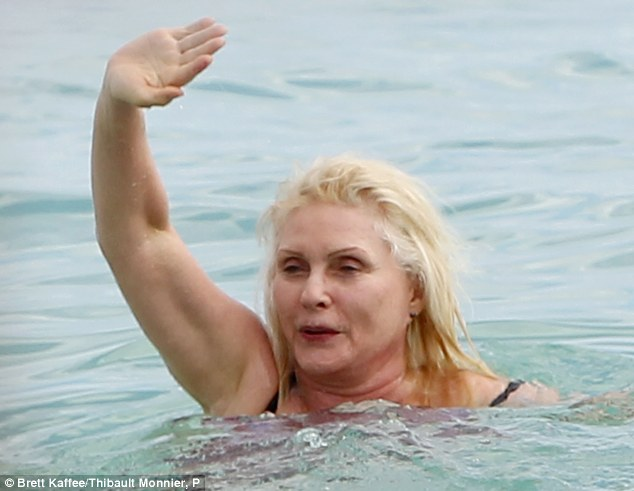 No messing around: The Blondie star proved she is happy to get stuck in as she swam in the waves