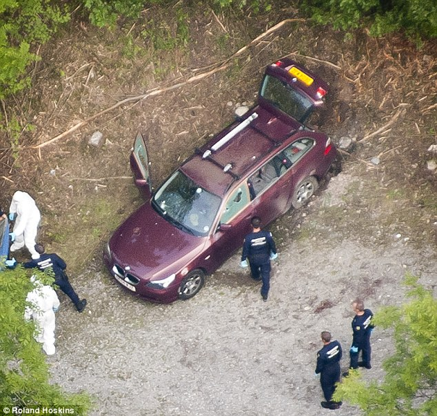 Murder: Photo of the car at the scene near Chevaline and Lake Annecy in the French Alps where Saad al-Hilli, his wife Iqbal and his 74-year-old mother-in-law were shot dead. French police have now arrested a man