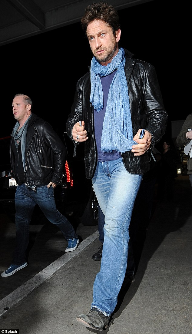 Edgy chic: Gerard Butler landed at the Los Angeles International Airport on Monday night, looking sleek and chic in an edgy leather jacket