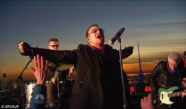 U2 perform on the roof of the Rockefeller Center for the debut of The Tonight Show with Jimmy Fallon on Monday night
