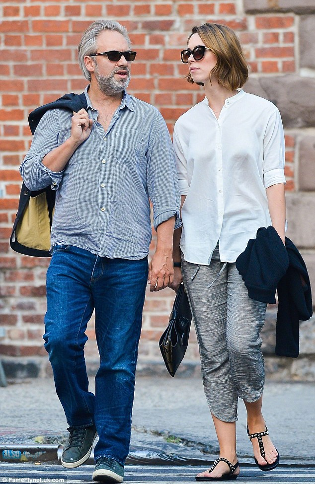 Love at last: The brunette beauty and long-time beau, director Sam Mendes, 48, took a walk in New York this past August