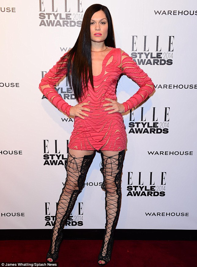 Thigh-catching: Jessie went for an eye-catching combination of a cut out sheer dress and thigh high black lace up boots