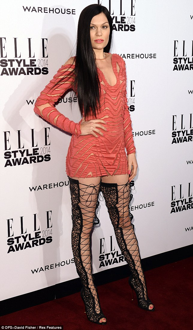 Dressed to thrill: Jessie looked like she had taken inspiration from 50 Shades of Grey in her raunchy lace up boots
