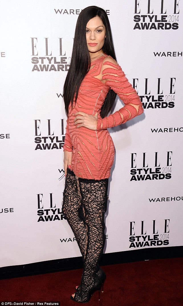 The thighs the limit: Jessie showed off her slim figure in her racy lace up boots