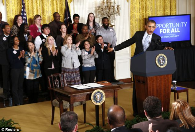President Barack Obama posed with a group of workers before signing an executive order to raise the minimum wage for federal contract workers to $10.10 an hour -- but his larger effort, which requires Congress to act, is now meeting with the CBO's brick wall