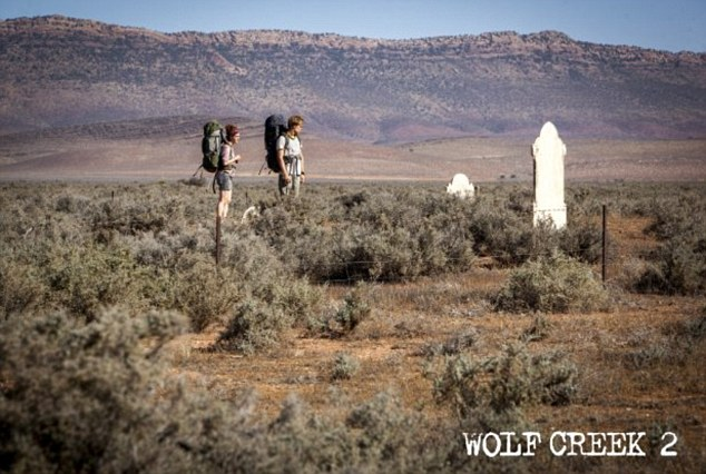 German backpackers Katarina and Rutger visit a desert grave in the Australian outback in Wolf Creek 2