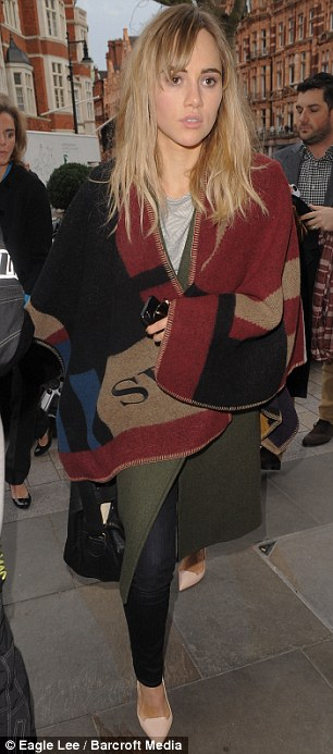 Not walking this time: Suki and Bradley headed to the Tom Ford LFW show together