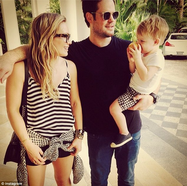 Amicable: Hilary and her estranged husband Mike Comrie enjoyed a Valentine's Day getaway with their son Luca