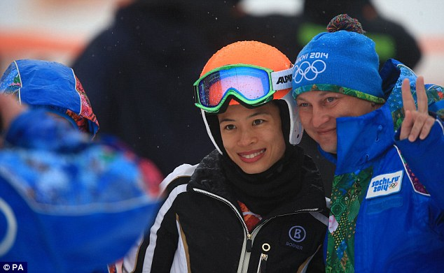 Popular: Vanessa-Mae poses for a picture with a safety marshall after completing her second run