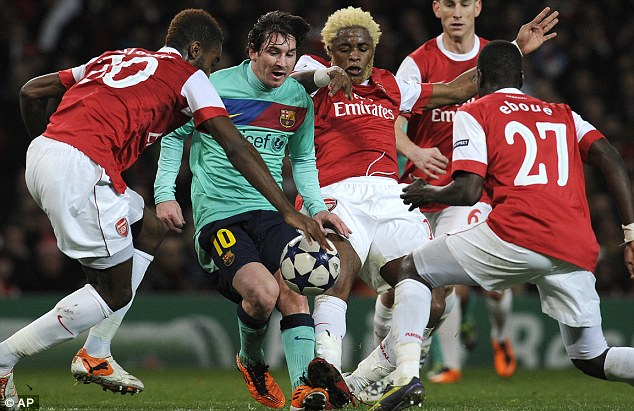 Crowded out: Messi could not score 12 months on as Arsenal were the 2-1 winners in North London