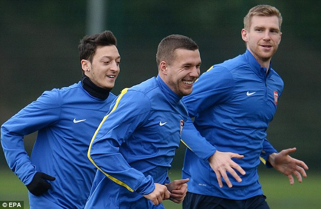 Personal criticism: Babbel has been surprised by 'lazy' Lukas Podolski's (centre) progress at Arsenal