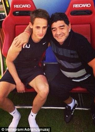 Embrace: Januzaj poses with Diego Maradona in Dubai this week