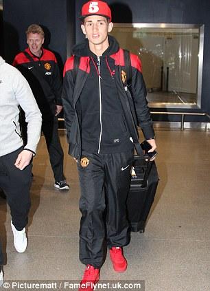 Welcome home: Adnan Januzaj arrives back from Dubai after Manchester United's warm-weather break