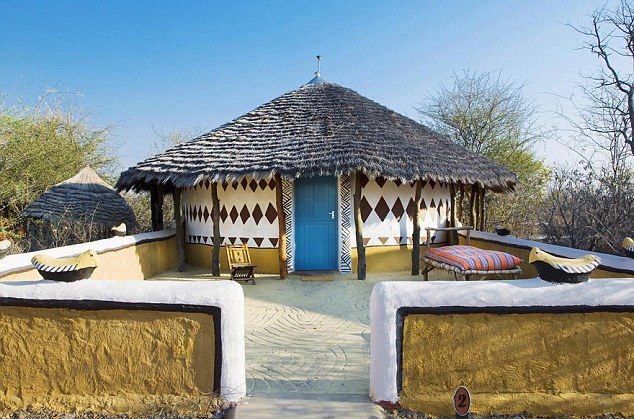 Characterful: Guests sleep in African thatched huts at Planet Baobab in Botswana