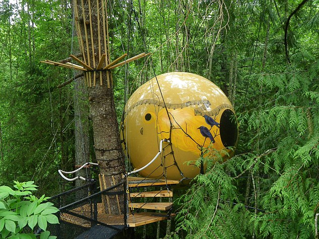 At the Free Spirit Spheres in Canada, guests sleep in spherical treehouses suspended amongst the trees