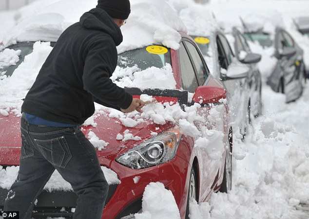 On the lookout: State troopers in Connecticut and New Jersey both say they¿ve written hundreds of tickets this winter season enforcing laws in each state requiring drivers to clear off their snow-covered vehicles before hitting the roads and highways