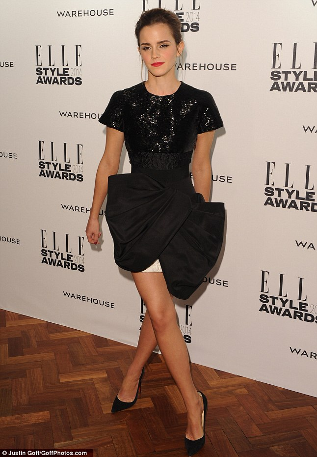 All wrapped up: Emma looked quirky and stylish in a sequin and black bow dress
