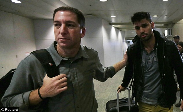 Greenwald (left) has been under fire that he might not have considered the cost to UK national security of publishing the secret documents