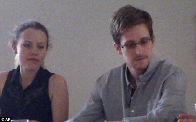 Edward Snowden (right) has been the subject of many theories that he could be a Russian mole planted or recruited inside the CIA