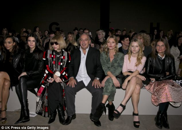 Spot the difference: The more usual LFW crowd: (L-R) Ashley Madekwe, Kendall Jenner, Anna Wintour, Sir Philip Green, Kate Moss, guest and Natalie Massenet attend the Topshop Unique show at London Fashion Week