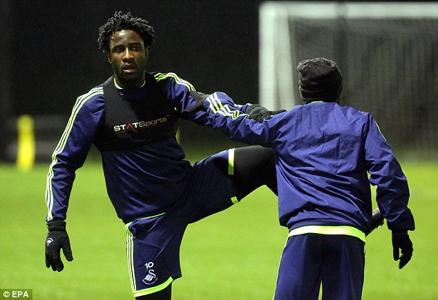 Wilf power! Swansea striker Bony stretches during a training session on the eve of the game